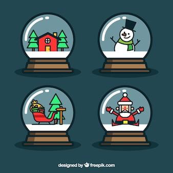 Set di quattro palle di neve con gli elementi tipici di natale
