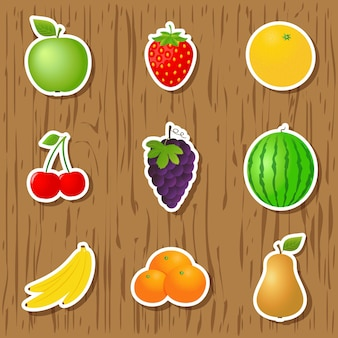 Set of fruit stickers on wood