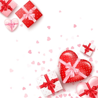 Set of gifts in square and hearts shaped boxes with silk ribbon and bow