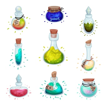 Set of glass bottles of different shapes with elixirs