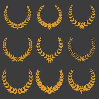 Set of gold monochrome vector wreaths on dark