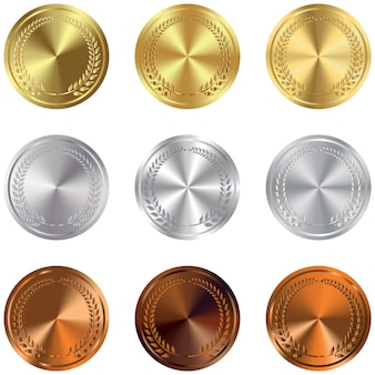 Set of gold, silver and bronze award medals on white.