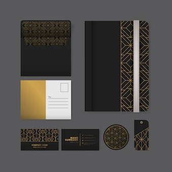 Set of golden geometric pattern on black surface stationery