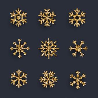 Set of golden glitter snowflakes on dark