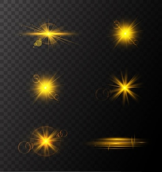 Set of golden glowing lights effects existing on transparent