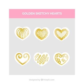 Set di cuori scarabocchi d'oro