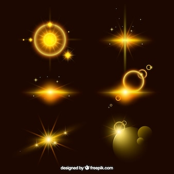 Set of golden lens flare with realistic style