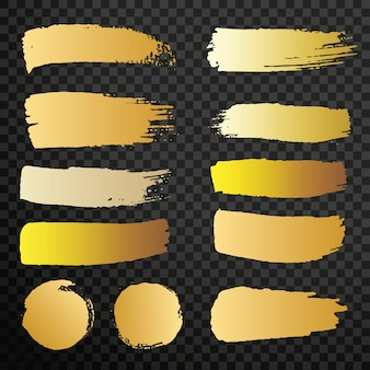 Set of golden paint brush isolated strokes