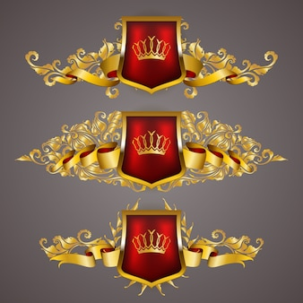 Set of golden royal shields with floral elements
