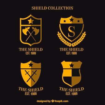 Set of golden shield badges in flat design