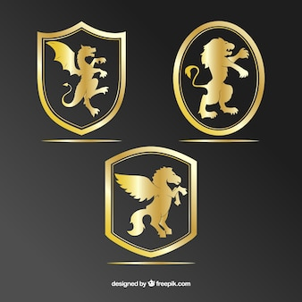 Set of golden shields with animals