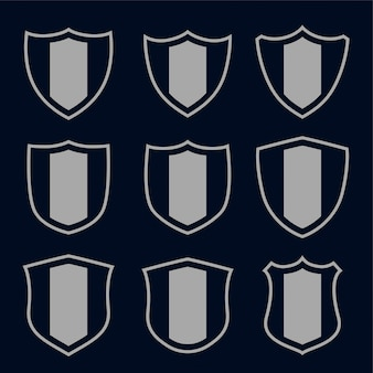 Set of gray shield symbols and signs