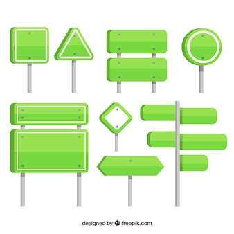 Set of green traffic signs
