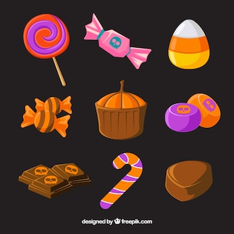 Set of halloween candies and cakes