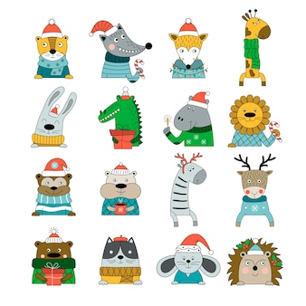 Set of hand-drawn animals in winter costumes isolated on white background.