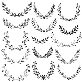 Set of hand drawn floral wreaths with branches, leaves, flowers, berries.