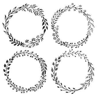 Set of hand drawn floral wreaths with leaves, flowers, berries.