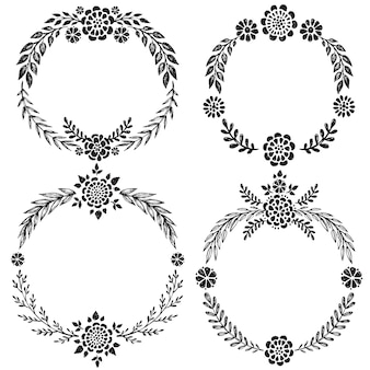 Set of hand drawn floral wreaths with leaves, flowers.