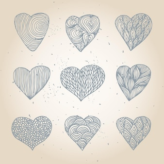 Set of hand drawn hearts with different pattern.