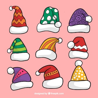 Set of hand drawn santa claus hats