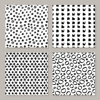 Set of hand-drawn seamless black and white patterns.