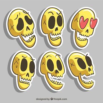 Set di disegnati a mano adesivi cranio