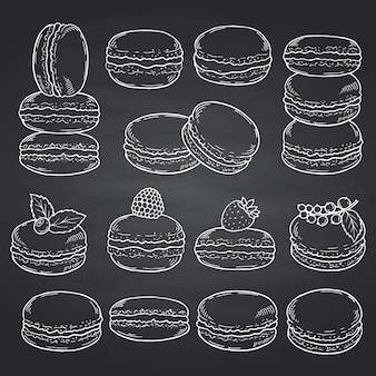 Set of hand drawn sweet macaroons on black chalkboard