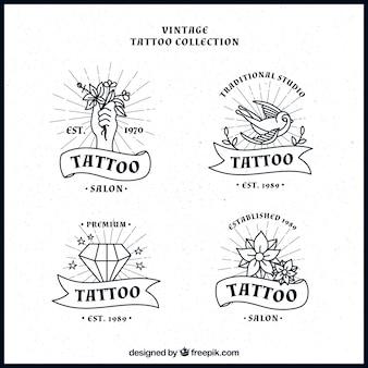 Set di tatuaggi disegnati a mano loghi
