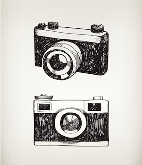Set of hand drawn vintage cameras isolated