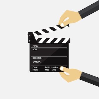 Set of hand holding movie clapperboard.