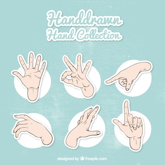 Set of hand sketches and sign language