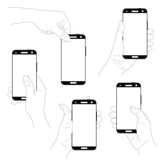 Set of hands holding vertical modern black smartphones isolated