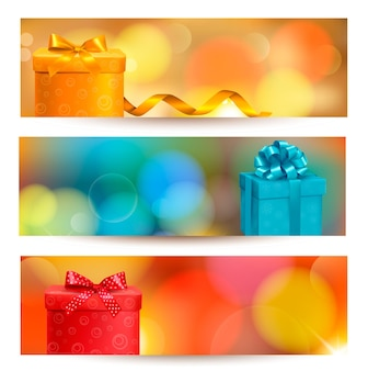 Set of holiday banners with gift boxes and ribbon.