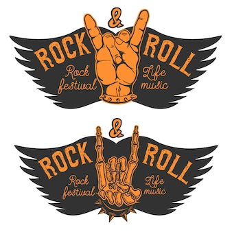 Set of the human hands with rock and roll sign and wings. rock and roll festival. design elements for poster, emblem.