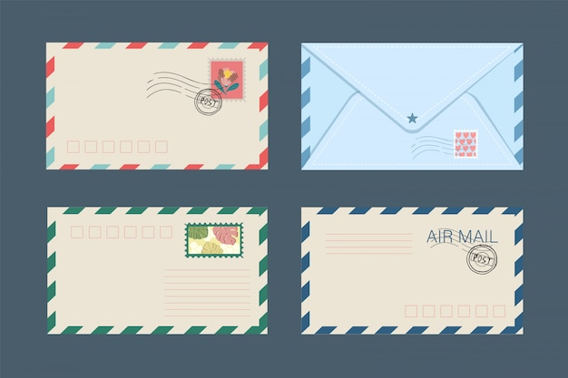 Set of isolated postal envelopes and postcards with postage stamps.