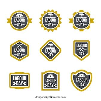 Set di etichette festa del lavoro con cornici gialle