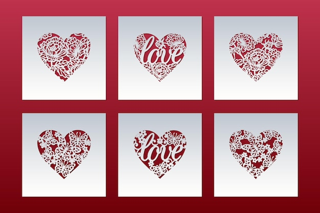 Set of laser cut cards with hearts patterned of butterflies and love lettering.