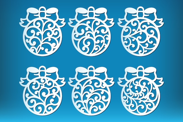 Set of laser cut christmas ball isolated on blue
