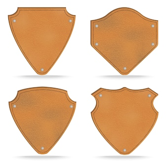 Set of leather tag labels on white