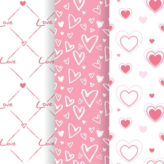 Set of lovely pink heart shape seamless patterns