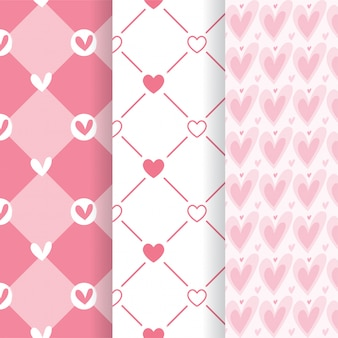 Set of lovely pink heart shape seamless patterns