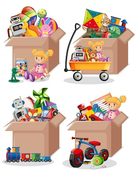Set of many toys in cardboard boxes on white