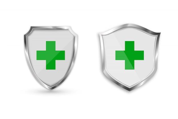緑の十字架と医療健康保護シールドを設定します。