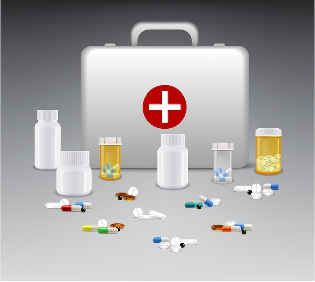 Set of medicine bottles with pills and first aid box