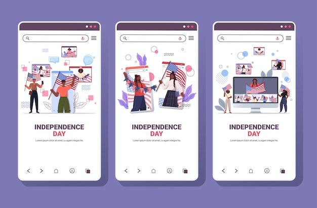 7 월 독립 기념일 개념 온라인 커뮤니케이션 스마트 폰 화면의 4 일 축하 미국 국기를 들고 혼합 인종 사람들을 설정