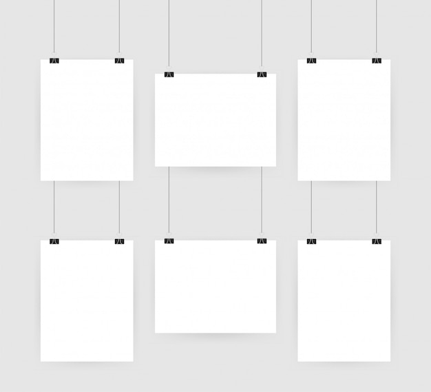 Set of multicolored binder clips on a piece of paper on transparent