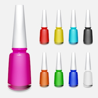 Set of multicolored bottles of nail polish on white background