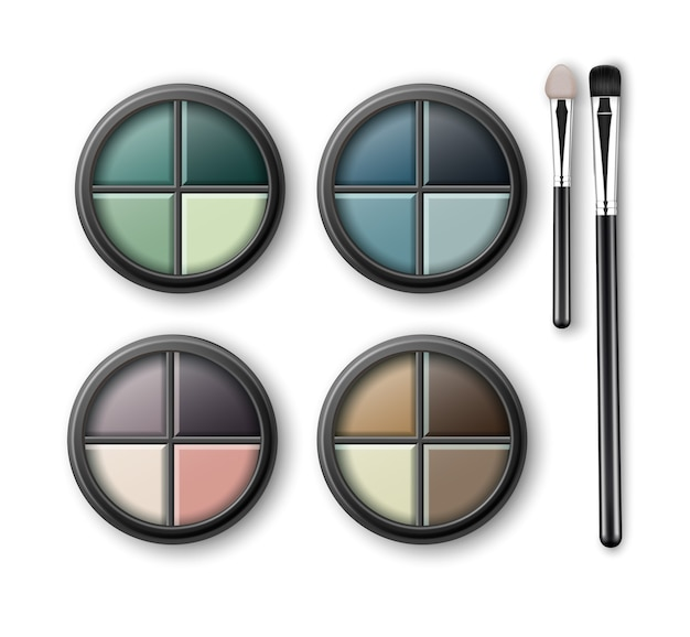 Set of multicolored light blue pink brown violet yellow turquoise ocher green emerald eye shadows in round black transparent plastic case with makeup brushes applicators isolated on background.