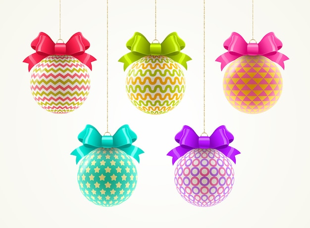 Set of multicolored patterned christmas baubles with color bow