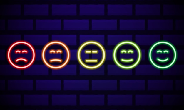 Set of neon smile emoticons isolated on dark brick wall  . line icons. happy and unhappy smileys. emoji set. colours emoji set.